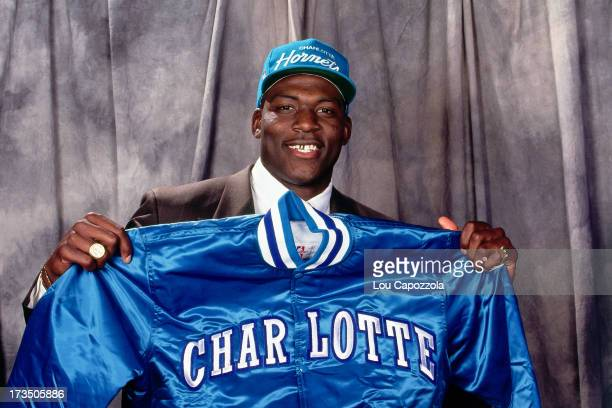 Rookie Larry Johnson of the Charlotte Hornets holds up a Hornets jacket during the 1991 NBA Draft at Madison Square Garden in New York New York NOTE...