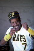 Rookie outfielder Barry Bonds of the Pittsburgh Pirates jokes with people in the dugout at McKechnie Field during spring training in March 1986 in...