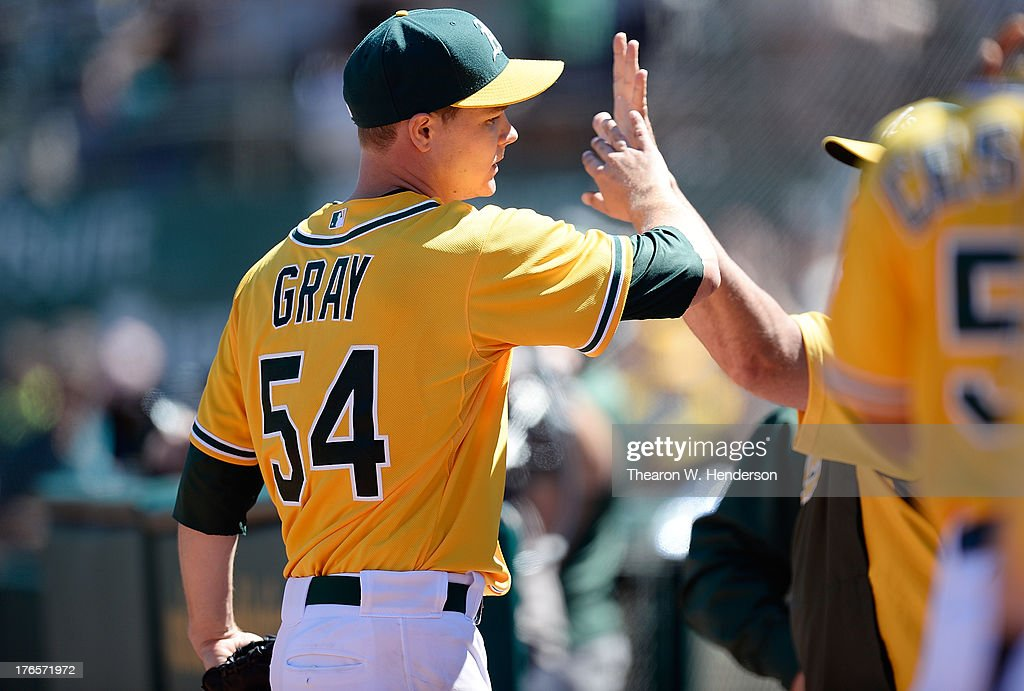 Rookie pitcher Sonny Gray #54 of the Oakland Athletics is congratulated by teammates for his performance against the Houston Astros at O.co Coliseum on August 15, 2013 in Oakland, California. Gray, the A's 2011 first round draft pick, pitched eight shutout innings, with nine strikeouts for his first career win.
