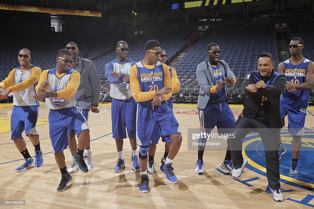Rookies of the Golden State Warriors perform the 'Gangnam Style' dance alongside hype man Franco Finn during the team's Open Practice at Oracle Arena on October 13, 2012 in Oakland, California.
