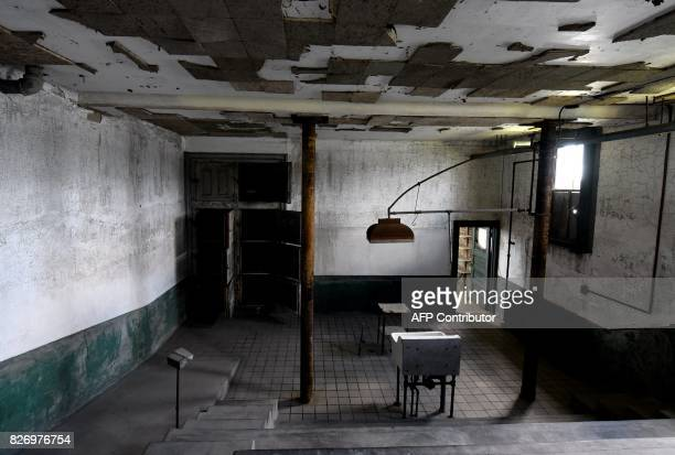 A room is seen in one of the buildings of the The Ellis Island Hospital on August 5 a 750bed facility which treated over 12 million patients and also...