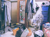Room is untidy with all clothes that were laundry but cannot manage to the closet