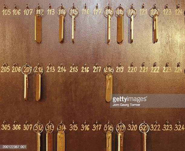Room keys hanging on numbered hooks