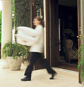 Room service attendant walking with pillows (blurred motion)