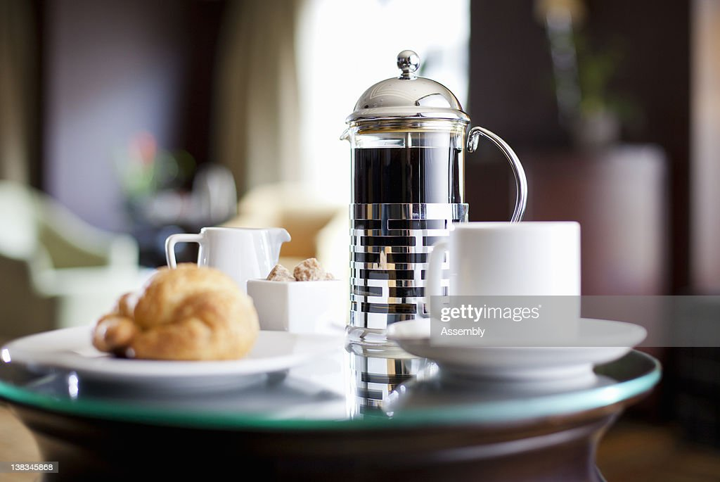 A room service breakfast tray in a hotel room : Stock Photo