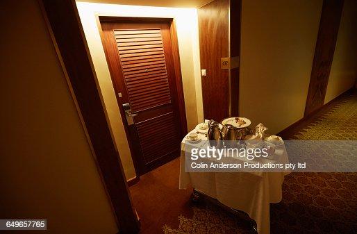 Room service cart in hotel hallway stock photo getty images for Hotel room service cart