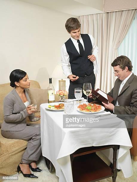 Room service waiter taking order