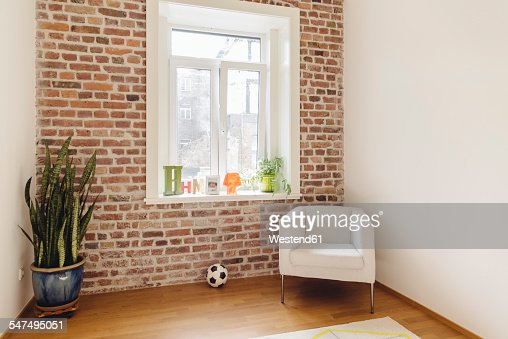 Room with brick wall in modern building