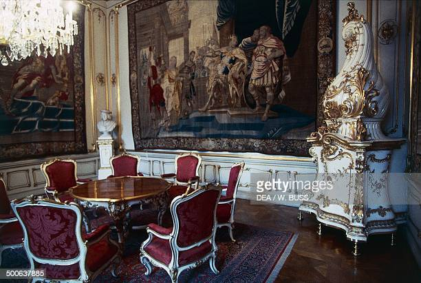 Room with table chairs and stove in the apartments of the Imperial Palace or Hofburg palace Vienna Austria 16th18th century