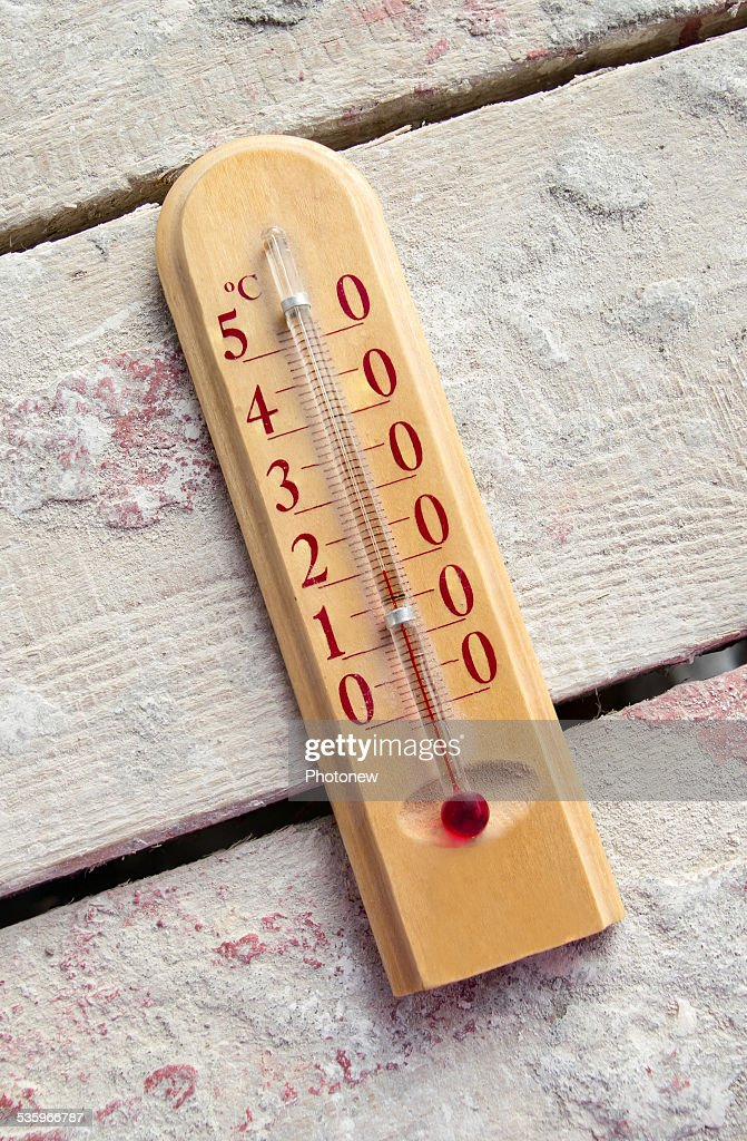 Room wooden thermometer on boards with cement : Stock Photo