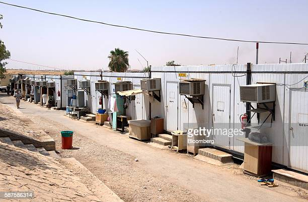 Rooms used to house foreign workers from South Asia stand along a street at the Saudi Oger labor camp set up by Saudi Oger Ltd in Riyadh Saudi Arabia...