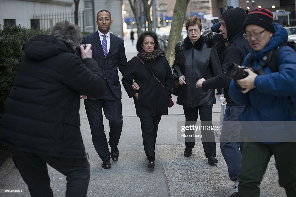 Roomy Khan, a former Intel Corp. executive, center, exits federal court accompanied by her attorney Stanislao German, left, following a sentencing hearing in New York, U.S., on Thursday, Jan. 31, 2013. Khan, twice convicted of passing illegal tips to Raj Rajaratnam, was sentenced to one year in prison today. Photographer: Scott Eells/Bloomberg via Getty Images