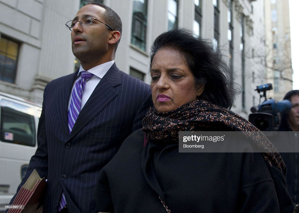 Roomy Khan, a former Intel Corp. executive, right, exits federal court with her attorney Stanislao German following a sentencing hearing in New York, U.S., on Thursday, Jan. 31, 2013. Khan, twice convicted of passing illegal tips to Raj Rajaratnam, was sentenced to one year in prison today. Photographer: Jin Lee/Bloomberg via Getty Images