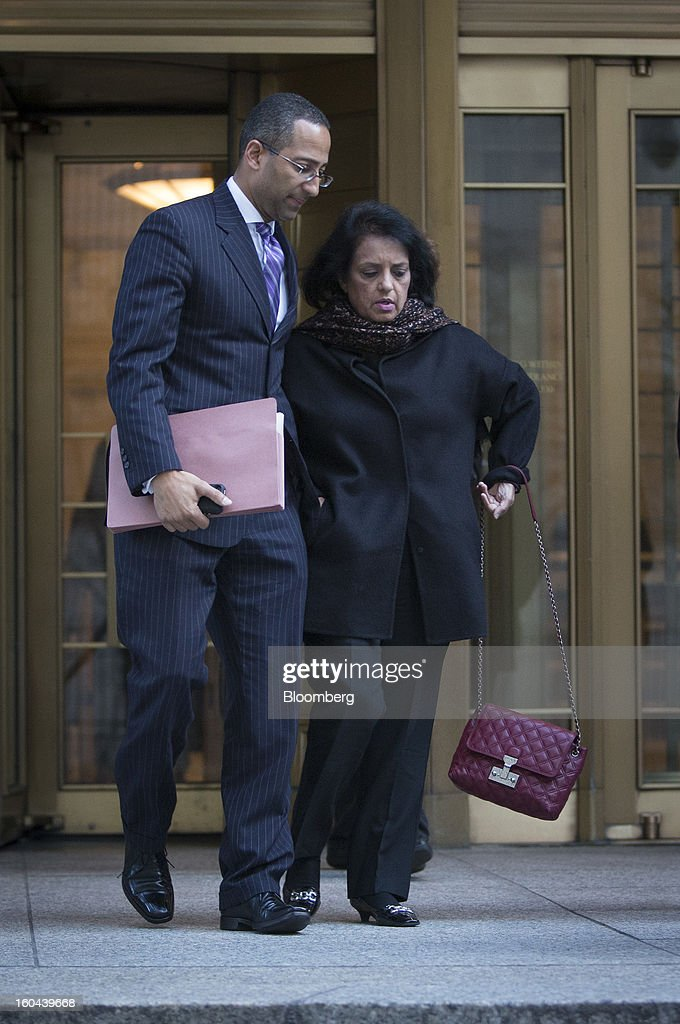 Roomy Khan, a former Intel Corp. executive, right, exits federal court with her attorney Stanislao German following a sentencing hearing in New York, U.S., on Thursday, Jan. 31, 2013. Khan, twice convicted of passing illegal tips to Raj Rajaratnam, was sentenced to one year in prison today. Photographer: Scott Eells/Bloomberg via Getty Images