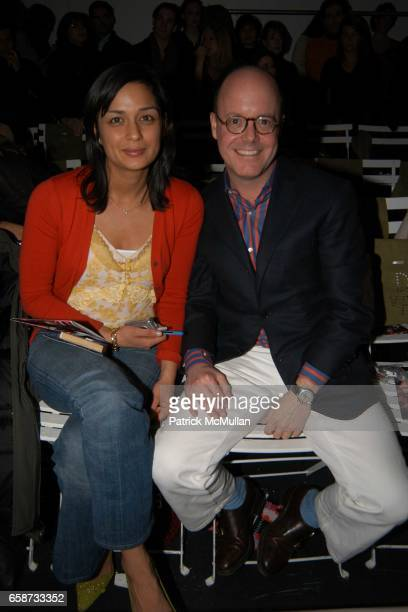 Roopal Patel and Robert Burke attend the front row at Diane von Furstenberg Fashion Show at DVF Studios on February 8 2004 in New York City
