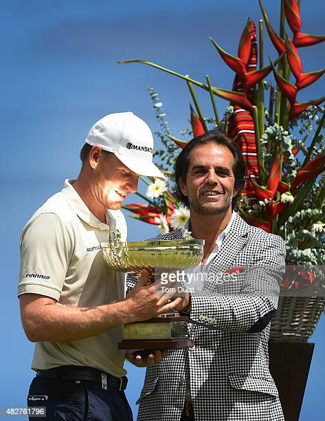 Roope Kakko of Finland poses with the trophy with Miguel Albuquerque after winning the Madeira Islands Open Portugal BPI at Club de Golf do Santo da...