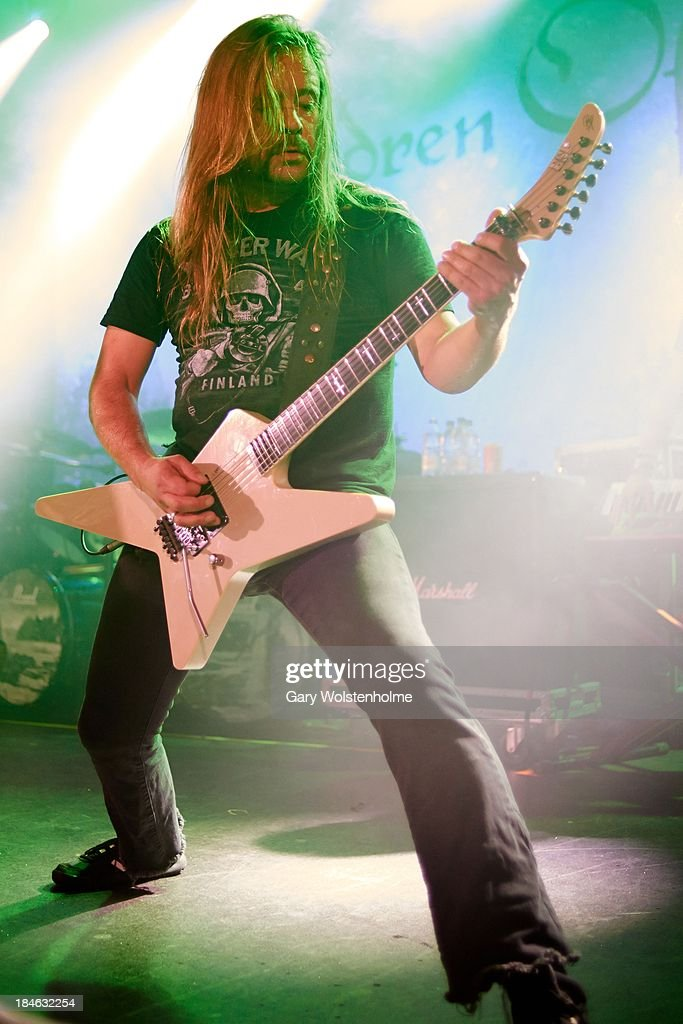 Roope Latvala of Children Of Bodom performs on stage at Manchester Academy on October 14 2013 in Manchester England