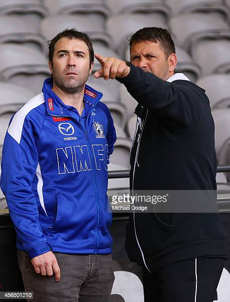Roos coach Brad Scott looks on with former Lions teamate Chris Johnson during the 2014 AFL Draft Combine at Etihad Stadium on October 2 2014 in...