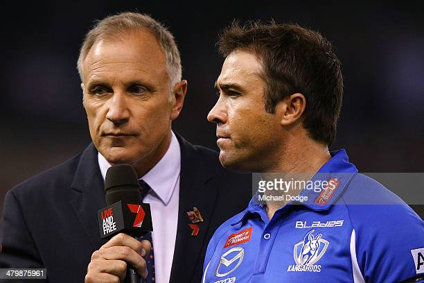 Roos coach Chris Scott speaks to Tim Watson of Channel Seven during the round one AFL match between the North Melbourne Kangaroos and the Essendon...