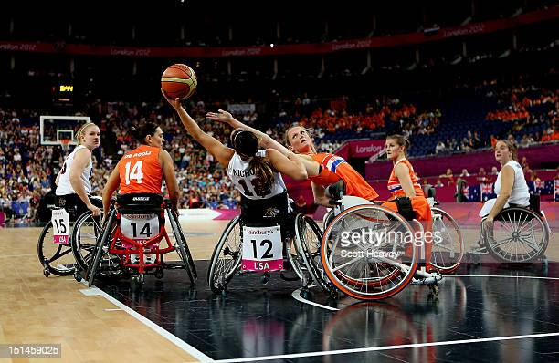 Roos Oosterbaan of Netherlands attempts to block a shot from Alana Nichols of United States during the Women's Wheelchair Basketball Bronze Medal...