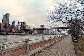 Roosevelt Island promenade. View on Queensboro bridge and Manhattan Skyline
