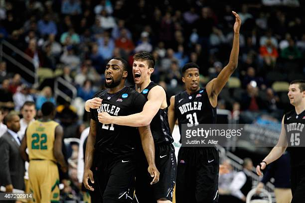 Roosevelt Jones of the Butler Bulldogs celebrates with teammate Kellen Dunham and Kameron Woods in the second half against the Notre Dame Fighting...