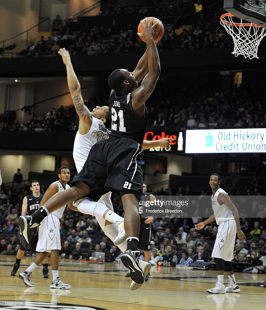 Roosevelt Jones #21 of the Butler Bulldogs collides with Kyle Fuller #11 of the Vanderbilt Commodores at Memorial Gym on December 29, 2012 in Nashville, Tennessee.