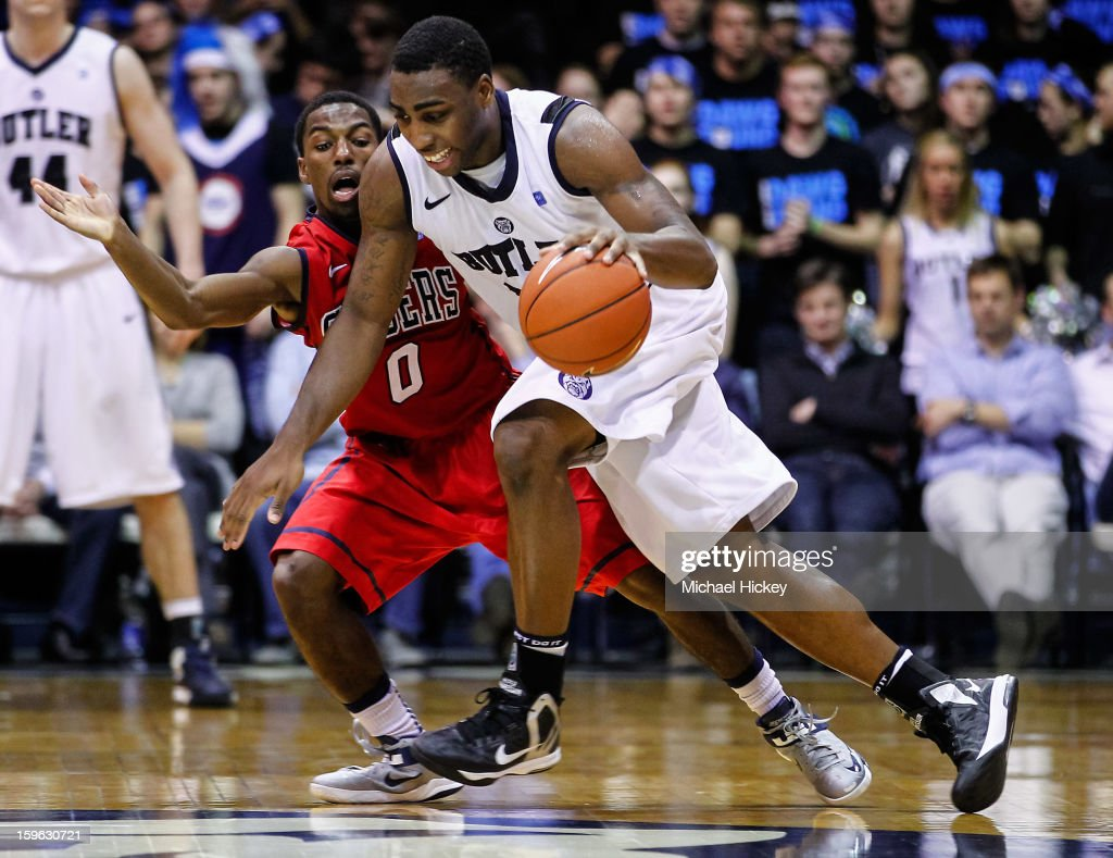 Roosevelt Jones #21 of the Butler Bulldogs dribble the ball against Kendall Anthony #0 of the Richmond Spiders at Hinkle Fieldhouse on January 16, 2013 in Indianapolis, Indiana. Butler defeated Richmond 62-47.