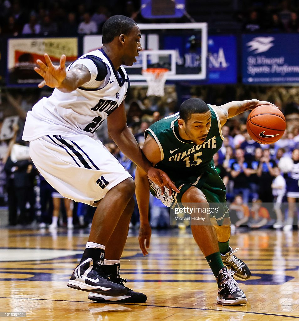 Roosevelt Jones #21 of the Butler Bulldogs guards as Pierria Henry #15 of the Charlotte 49ers dribbles to the hoop at Hinkle Fieldhouse on February 13, 2013 in Indianapolis, Indiana. Charlotte defeated Butler 71-67.