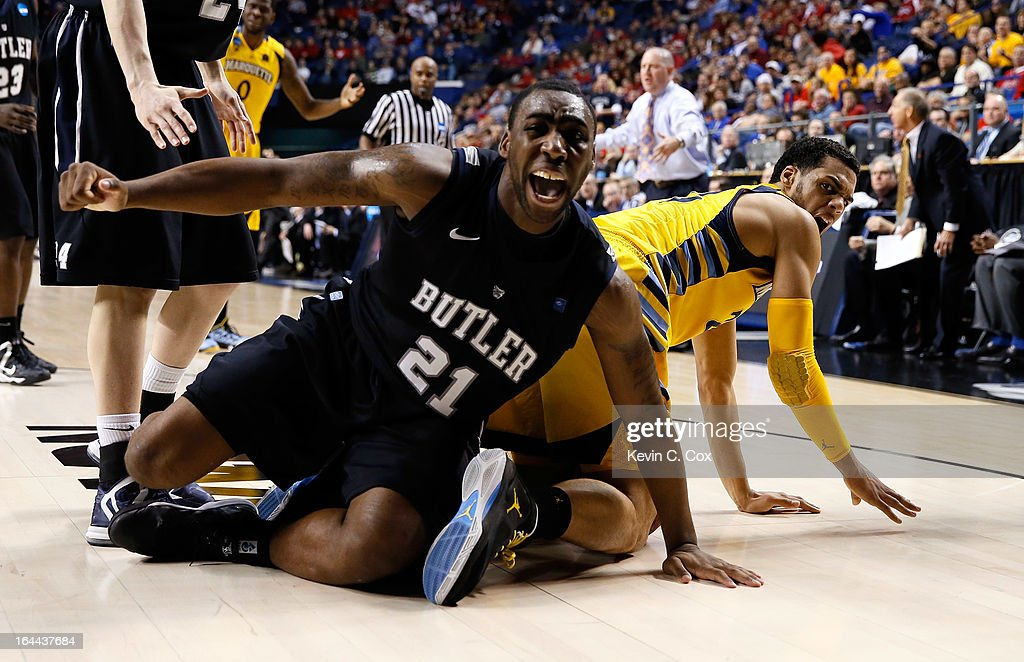 Roosevelt Jones #21 of the Butler Bulldogs reacts after a foul is called on him against Trent Lockett #22 of the Marquette Golden Eagles in the second half during the third round of the 2013 NCAA Men's Basketball Tournament at Rupp Arena on March 23, 2013 in Lexington, Kentucky.