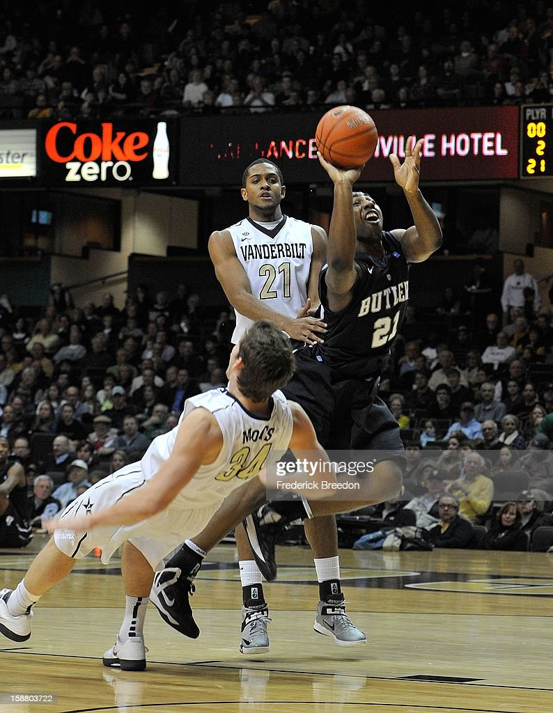 Roosevelt Jones #21 of the Butler Bulldogs runs into Shelby Moats #34 of the Vanderbilt Commodores at Memorial Gym on December 29, 2012 in Nashville, Tennessee.