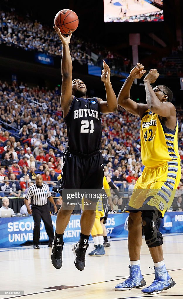 Roosevelt Jones #21 of the Butler Bulldogs shoots against Chris Otule #42 of the Marquette Golden Eagles in the first half during the third round of the 2013 NCAA Men's Basketball Tournament at Rupp Arena on March 23, 2013 in Lexington, Kentucky.