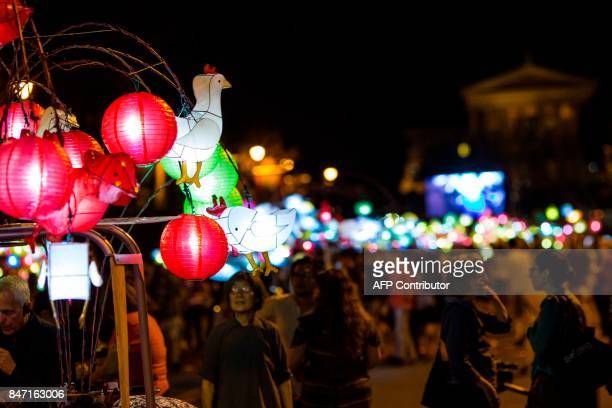 A rooster lantern is seen in honor of the Chinese zodiac as people watch the grand opening of Chinese artist Cai GuoQiang's latest work 'Fireflies'...