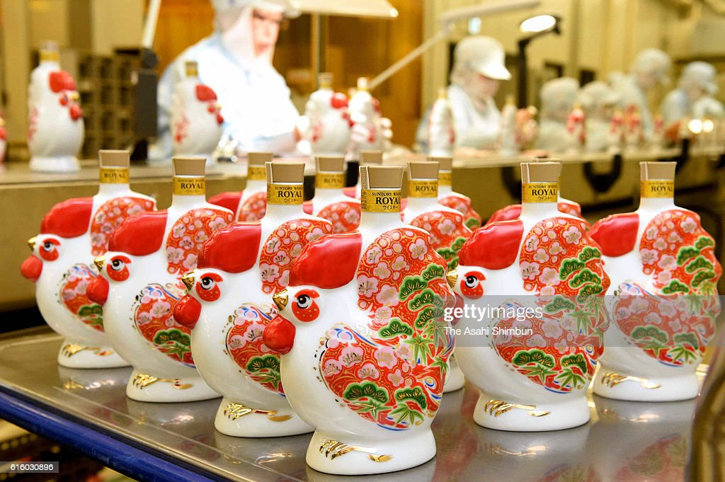 Rooster shaped bottles of whisky are produced at Suntory's Yamazaki distillery on October 21, 2016 in Shimamoto, Osaka, Japan. Rooster is next year's zodiac sign.