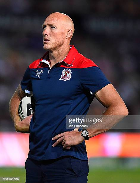 Roosters assistant coach Craig Fitzgibbon looks on before the start of the round one NRL match between the North Queensland Cowboys and the Sydney...
