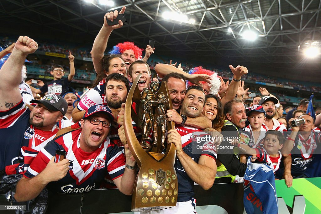 Roosters captain <a gi-track='captionPersonalityLinkClicked' href=/galleries/search?phrase=Anthony+Minichiello&family=editorial&specificpeople=211500 ng-click='$event.stopPropagation()'>Anthony Minichiello</a> celebrates with fans after winning the 2013 NRL Grand Final match between the Sydney Roosters and the Manly Warringah Sea Eagles at ANZ Stadium on October 6, 2013 in Sydney, Australia.