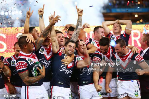 Roosters captain Anthony Minichiello celebrates with team mates after victory during the 2013 NRL Grand Final match between the Sydney Roosters and...