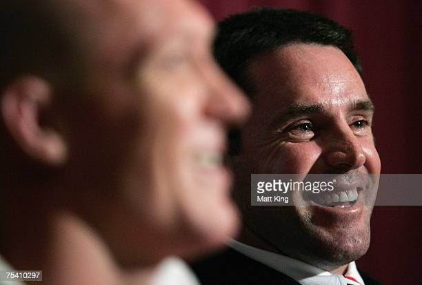 Roosters coach Brad Fittler laughs next to Craig Fitzgibbon at the post match press conference following the round 18 NRL match between the Sydney...