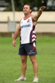 Roosters coach Ricky Stuart talks to his players during a Sydney Roosters training session at Wentworth Park March 21 2006 in Sydney Australia