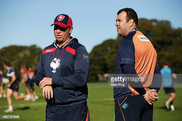 Roosters coach Trent Robinson speaks to Waratahs coach Michael Cheika during a joint training session between the Waratahs and the Sydney Roosters at...