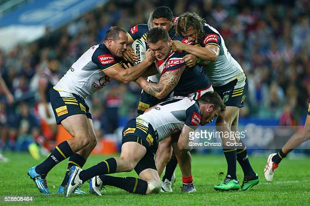 Roosters Jared WaereaHargreaves is tackled by Cowboys Gavin Cooper Matt Scott Ashton Sims and Jason Taumalolo during the match at Allianz Stadium...