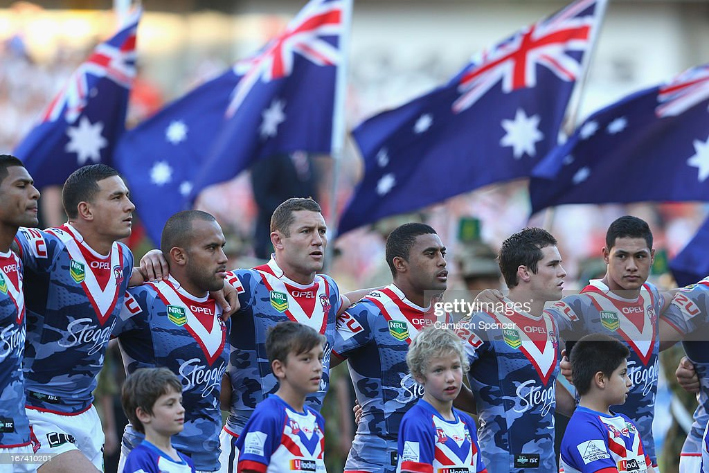 Roosters players line up for the Australian national anthem during an ANZAC day ceremony prior to the round seven NRL match between the Sydney Roosters and the St George Illawarra Dragons at Allianz Stadium on April 25, 2013 in Sydney, Australia.