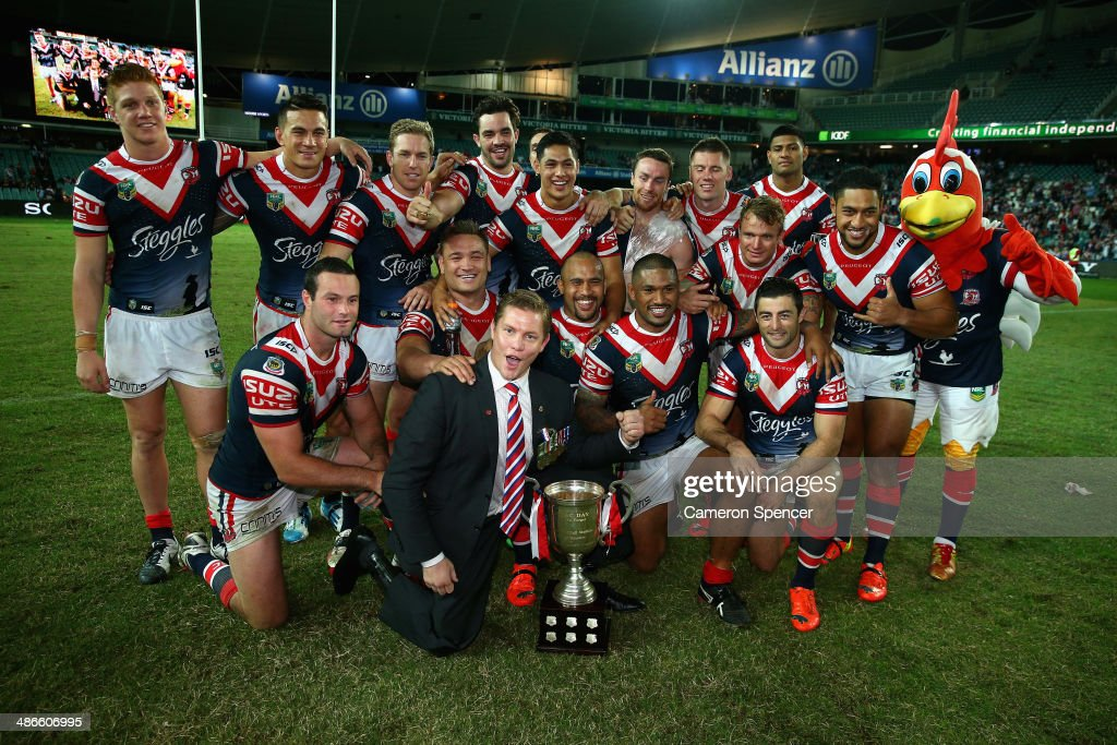 Roosters players pose with former Australian commando Damien Thomlinson after winning the ANZAC Cup after winning the round 8 NRL match between the St George Illawarra Dragons and the Sydney Roosters at Allianz Stadium on April 25, 2014 in Sydney, Australia.