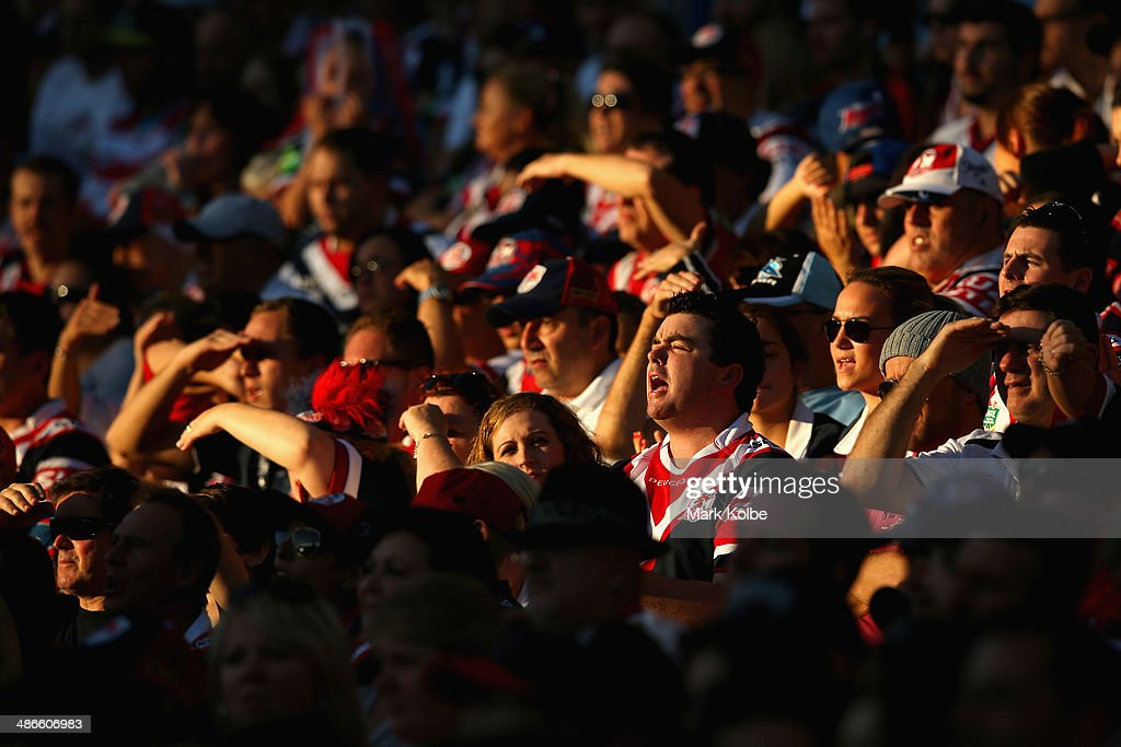 A Roosters supporter in the crowd cheers during the round 8 NRL match between the St George Illawarra Dragons and the Sydney Roosters at Allianz Stadium on April 25, 2014 in Sydney, Australia.