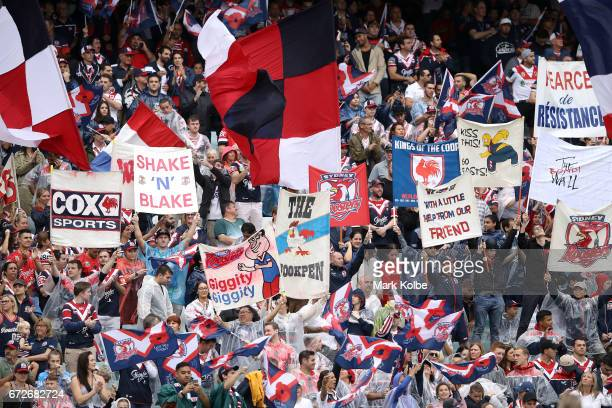Roosters supporters cheer during the round eight NRL match between the Sydney Roosters and the St George Illawarra Dragons at Allianz Stadium on...