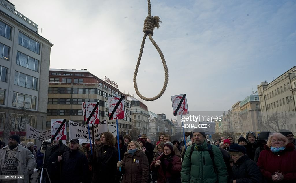 A rope is seen as people hold up pictures of first Czech communist President Klement Gotwald, Russian President Leonid Breznev and J V Stalin as they demonstrate against raising influence of communism inside the Czech politic scene on January 19, 2013, at the Wenceslas Square in Prague, Czech.