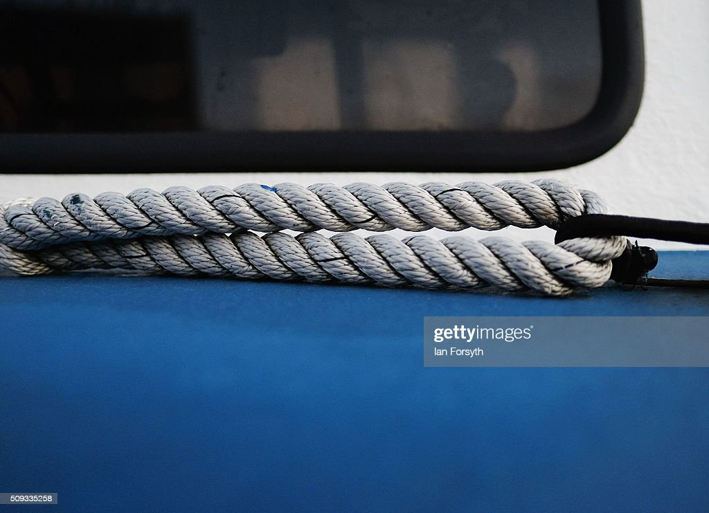 A rope tied to the deck of a fishing boat parked on the seafront can be seen on February 10, 2016 in Redcar, England. The inshore fishing fleet at Redcar originated in the early 14th Century with crab, lobster and fishing bringing in much needed income to local fishermen. As the fishing industry has steadily declined so to the fleet has reduced in size so that today only a small number of boats still put to sea from the town to continue the fishing heritage on the east coast of England.