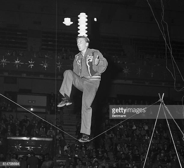 Rope walker Dieter Tasso balances cups and saucers on his head as walks on a slack wires
