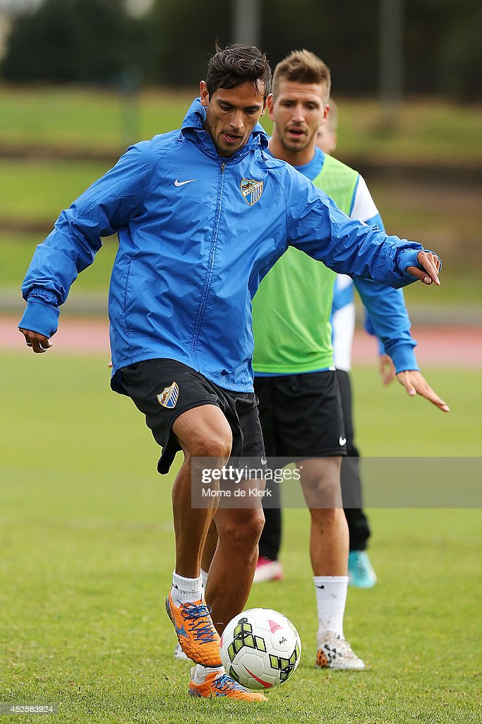 <a gi-track='captionPersonalityLinkClicked' href=/galleries/search?phrase=Roque+Santa+Cruz&family=editorial&specificpeople=224915 ng-click='$event.stopPropagation()'>Roque Santa Cruz</a> kicks the ball during a Malaga CF training session at Santos Stadium on July 24, 2014 in Adelaide, Australia.