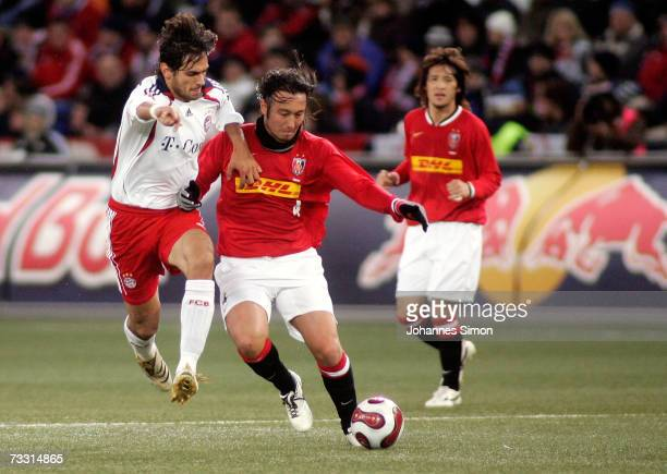 Roque Santa Cruz of Bayern Munich and Marcus Tulio Tanaka of Urawa Red Diamonds during the Red Bulls Cup match between Urawa Red Diamonds and Bayern...